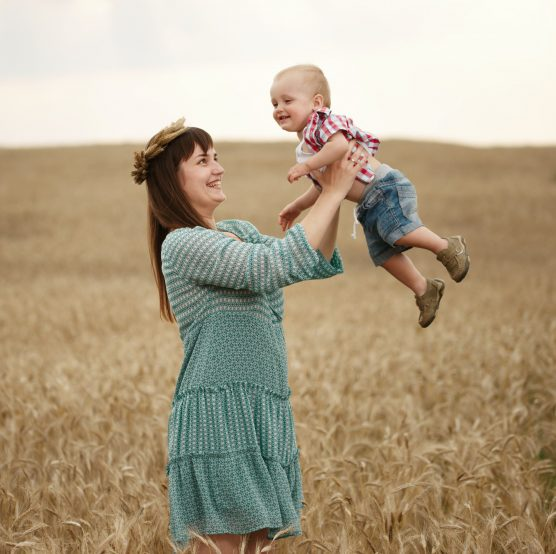 happy mother with son in the field